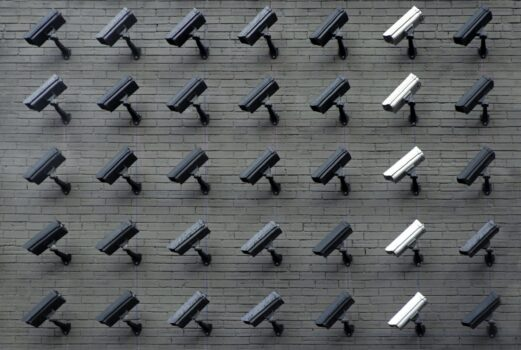 assorted-color security cameras